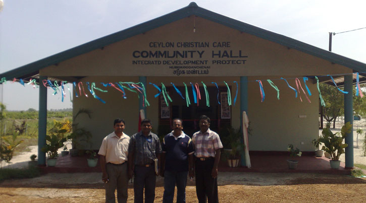 Local staff in front of the Community Hall, CCC:LoH, Sri Lanka