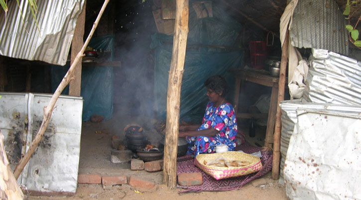 Women cooking meals in bad circumstances, CCC:LoH Sri Lanka